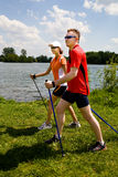 Nordic walking. Tour in summer Royalty Free Stock Photo