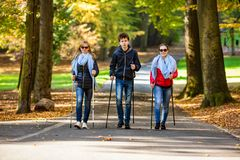 Nordic walking - active people working out. In park Stock Photography