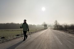 Nordic Walking in the backlight Stock Photos