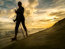 Nordic walking on the beach Stock Images