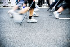 Nordic walking on city marathon, motion blur Stock Images