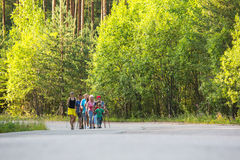 Nordic walking devoted to the Day of Health. NIKOLSKY, RUSSIA - JULY 14: Participants (kids: Nikolay Dubinin /, Darja Zhochkina /6) during of local competitions Royalty Free Stock Photo