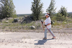 Nordic Walking - elderly woman is hiking  in the summer Royalty Free Stock Photo