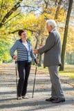 Nordic walking. Elderly women on nordic walking meeting her old friend stock photo