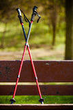 Nordic walking equipment on the park bench. Nordic walking on the park bench. Active and healthy lifestyle Royalty Free Stock Images