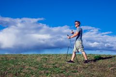 Nordic walking, exercise, adventure, hiking concept -man hiking royalty free stock photo