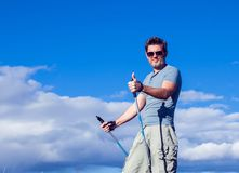 Nordic walking, exercise, adventure, hiking concept -man hiking royalty free stock images