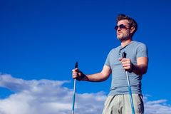 Nordic walking, exercise, adventure, hiking concept -man hiking stock images
