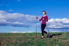 Nordic walking, exercise, adventure, hiking concept -a woman hiking in the nature stock photos