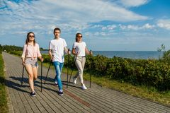 Nordic walking- family training at seaside royalty free stock photos