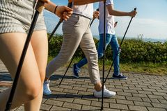 Nordic walking- family training at seaside stock photo