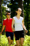 Nordic walking in forest Royalty Free Stock Photography