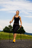 Nordic walking girl 1 Royalty Free Stock Images