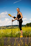 Nordic walking girl. Nordic walking in summer. Stretching for a walk Stock Image