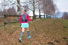 Nordic walking Girl in autumn path stock image