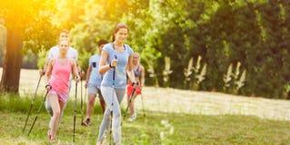 Nordic walking group hiking stock photos