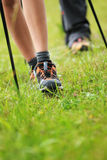 Nordic walking legs in mountains Stock Image