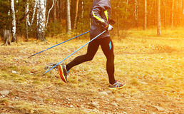 Nordic walking man. Athlete jogging. sport outdoors Stock Photography