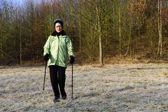Nordic Walking on a meadow Stock Image