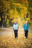Nordic walking. Mother and daughter train nordic walking Stock Photo