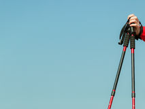 Nordic walking. Red sticks on blue sky background Stock Photography
