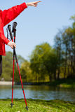Nordic walking. Red sticks on grass in park Royalty Free Stock Photos