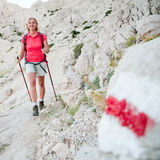 Nordic walking on red trail Stock Image