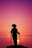 Nordic walking silhouette at sunset Royalty Free Stock Photo