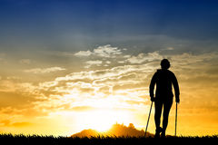 Nordic walking silhouette at sunset Royalty Free Stock Photos