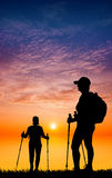 Nordic walking silhouette at sunset Stock Photo
