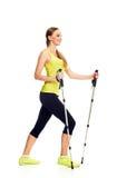 Nordic walking slim woman full length Royalty Free Stock Photography