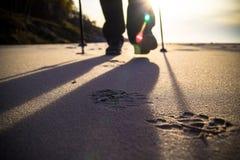 Nordic walking sport run walk motion blur outdoor person legs ra. Feet cultivating man nordic walking on the beach Stock Photography