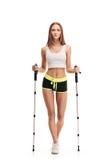 Nordic walking sporty woman full length portait Stock Photos