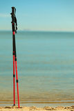 Nordic walking. sticks on a sandy beach. ocean view Stock Photography