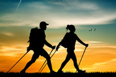 Nordic walking at sunset Royalty Free Stock Photography