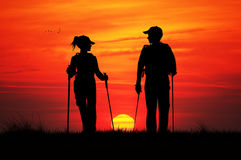 Nordic walking at sunset Stock Photography