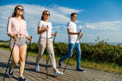 Nordic walking- family training at seaside Royalty Free Stock Images