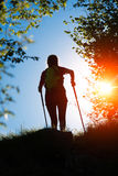 Nordic walking towards the sun in nature Royalty Free Stock Image