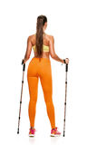 Nordic walking woman from back Royalty Free Stock Photo