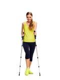 Nordic walking woman full length Royalty Free Stock Image