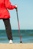 Nordic Walking. Woman Hiking On The Beach. Royalty Free Stock Photos