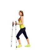 Nordic walking woman in profile Stock Photos