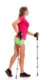 Nordic walking woman in profile Royalty Free Stock Image