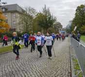 Nordic walking Women with smiles Sport holiday, marathon in Germany, Magdeburg, oktober 2015. Nordic walking. Women with smiles come with sticks Sport holiday Stock Photos