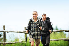 Nordic Walking. Young cheerful couple enjoying a nordic walk Stock Photo
