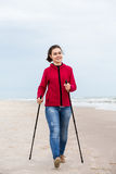Nordic walking - young girl working out on beach Royalty Free Stock Photo