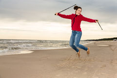 Nordic walking - young girl working out on beach Royalty Free Stock Image