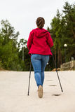 Nordic walking - young girl working out on beach Stock Photography