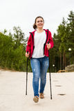 Nordic walking - young girl working out on beach Stock Images