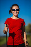 Nordic walking - young girl working out Stock Photography